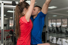 Couple Athlete Doing Pull-ups In Gym Royalty Free Stock Photos