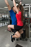 Couple Athlete Doing Pull Ups In Gym Stock Photos
