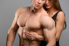 Couple of athlete lovers without faces posing on Stock Photos