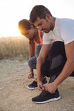Couple of athletes getting ready for running Stock Image
