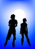 Couple athletes on moon Stock Image