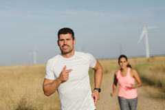 Couple of athletes running together Stock Images