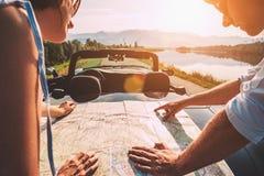 Couple auto travelers plans itinerary. Couple auto travelers plans their itinerary royalty free stock photos