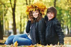 Couple at autumn outdoors Royalty Free Stock Photo