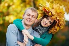 Couple at autumn outdoors Stock Photo
