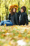 Couple at autumn outdoors Royalty Free Stock Images