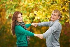 Couple at autumn outdoors Royalty Free Stock Photo