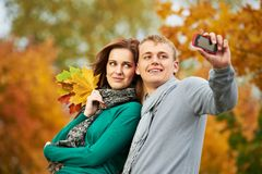 Couple at autumn outdoors Stock Images