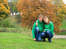 Couple in autumn park Stock Images