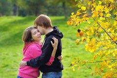 Couple in autumn park Royalty Free Stock Photography