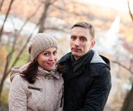 Couple in autumn park. Young couple on walk in autumn park royalty free stock photos