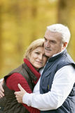 Couple on an autumn walk. Mature couple on an autumn walk Royalty Free Stock Photography