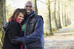 Couple On Autumn Walk. Smiling at camera Royalty Free Stock Photo