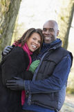 Couple On Autumn Walk. Smiling at camera close up Royalty Free Stock Image