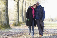 Couple On Autumn Walk. Smiling at camera whilst walking Stock Photos