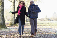 Couple On Autumn Walk. Running and smiling Royalty Free Stock Photo