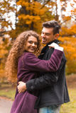 Couple on autumn walk Stock Images