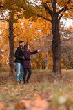 Couple on autumn walk Royalty Free Stock Images
