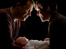 Couple with baby stock image