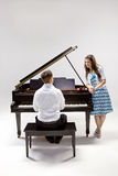 Couple with baby Grand piano 2 Royalty Free Stock Images