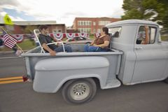Couple in the back of a pickup truck for the Independence Day Parade, in Lima Montana Royalty Free Stock Photography