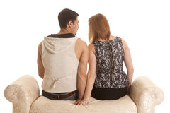 Couple back sit hold hands Stock Images
