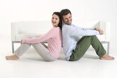 Couple back to back Royalty Free Stock Photo