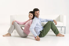 Couple back to back Royalty Free Stock Images