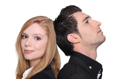 Couple back to back Stock Photography