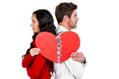 Couple back to back holding heart halves. On white background Stock Photography