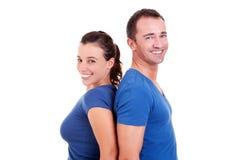 Couple  back to back smiling. Isolated on white, studio shot Stock Photography