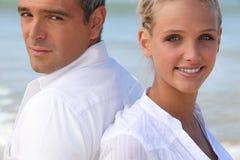 Couple back to back. Young couple back to back Stock Photo