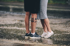 Couple on the background of wet asphalt Stock Images