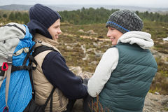 Couple with backpack relaxing while on a hike Royalty Free Stock Photography