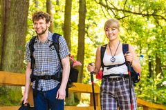 Couple backpacker hiking in forest pathway. Adventure, tourism active lifestyle- young couple backpacker hiking in forest pathway Stock Photos
