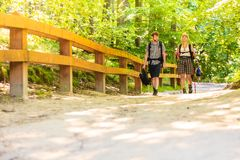 Couple backpacker hiking in forest pathway stock photo