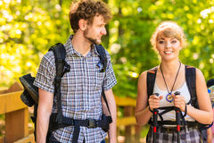 Couple backpacker hiking in forest pathway. Adventure, tourism active lifestyle- young couple backpacker hiking in forest pathway Royalty Free Stock Photos