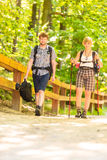 Couple backpacker hiking in forest pathway. Adventure, tourism active lifestyle- young couple backpacker hiking in forest pathway Stock Image