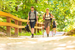 Couple backpacker hiking in forest pathway. Adventure, tourism active lifestyle- young couple backpacker hiking in forest pathway Stock Images