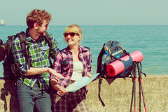 Couple backpacker with map by seaside Royalty Free Stock Image