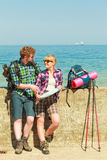 Couple backpacker with map by seaside Stock Photography
