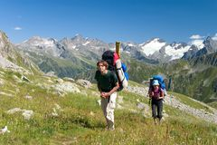 Couple of backpacker in mountains royalty free stock photography