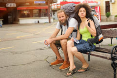 A couple of backpacker tourists sitting on a bench Stock Photo