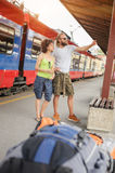 A couple of backpacker tourists waiting to board a train Stock Photography
