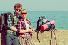 Couple backpacker tramping by seaside Stock Photo