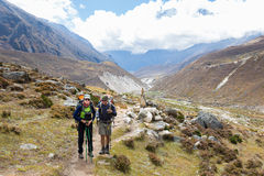 Couple backpackers hiking mountain trail in Nepal. Stock Images