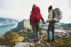 Couple backpackers holding hands enjoying mountains. View family traveling together adventure lifestyle concept hiking vacations outdoor royalty free stock photography