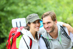 Couple of backpackers taking selfie in forest royalty free stock photo