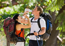 Couple with backpacks Royalty Free Stock Images