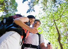 Couple with backpacks and compass Stock Photography